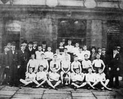 A young Joe seated third from the right with his fellow Bolton Harriers in 1900