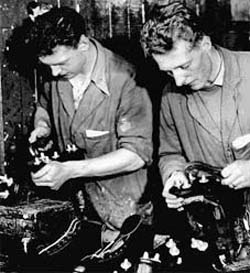 Jeff (left) and Joe Foster finishing football boots in 1958